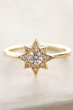 Gold star shaped ring with little diamonds. So cute and perfect for layering.