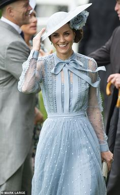 Kate holding onto her hat today