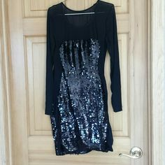 Black sequin dress New without tags, mesh sleeves and down the side Dresses