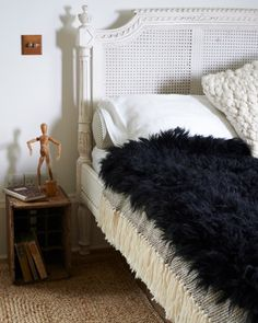 Super cosy bedroom with a sheep fur throw from www.purelana.com