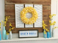 Summer mantel diy's with fabric rag wreath, painted recycled bottles, and beach sign made with Chalk Couture transfer, chalk pastes, and box frame. Beach House Signs, Beach Signs, Summer Mantel, Diy Mantel, Strawberry Flower, Different Holidays, Types Of Craft, White Backdrop, Recycled Bottles
