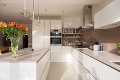 large contemporary kitchen extension opening up the rear of the property to create an open plan kitchen, diner and living space. Side Return Extension, Open Plan Kitchen, Living Spaces, Kitchen Cabinets, Contemporary, Kitchen Extensions, Construction, Interiors, Create