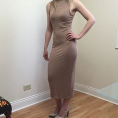 Sleeveless Midi Dress Perfect casual look. Very soft stretchy material. Sleeveless design with high neck. Armpit 14in.  Waist 12in. Length 45in. Rich taupe color. Dresses Midi