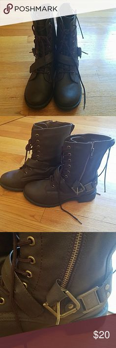 Brown combat boots size 7 Never worn size 7 Brown combat boots.  Lace up with a strap at the bottom Zipper and buckles on the side  Send me an offer !! Wet Seal Shoes Combat & Moto Boots
