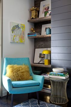 Birch + Bird Vintage Home Interiors rough wooden shelves, midcentury blue linen armchair and side table, patterned rug, horizontal slats, bright colors