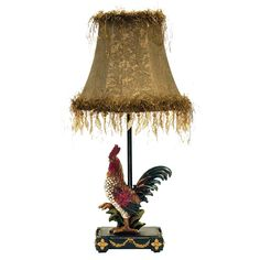 The Petite Rooster table lamp is finished in ainsworth. The lamp is 9 inches wide x 19 inches high and requires one 40-watt medium base bulb.