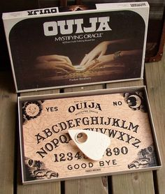 Ouija - btw... still sells in your local toy store... and comes in pink too... making it not so scarey when conjuring a demon.