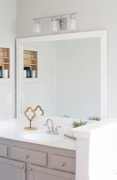Framing a builder's grade bathroom mirror is an easy way to update your bathroom on a budget. A full tutorial is here. diy bathroom decor How to Build a DIY Frame to Hang over a Bathroom Mirror ⋆ Love Our Real Life Diy Vanity Mirror, Bathroom Mirrors Diy, Small Bathroom, Bathroom Ideas, Basement Bathroom, Bathroom Designs, Bathroom Layout, Bathtub Ideas, Framed Mirrors