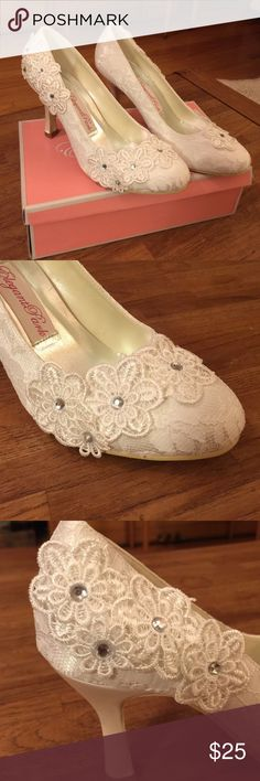"Elegant Park ""Fascinator"" Pumps Beautiful round toed pumps for a special occasion.  They are an ivory color with lace covered satin for the upper.  There are pretty lace flowers and lovely ""diamond"" beading on the heals and toes.  They have never been worn and come new, in the box.  They say the size is a ""40""; however, I am an 8-1/2 and they fit me perfectly. Elegant Park Shoes Heels"