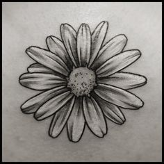 What does daisy tattoo mean? We have daisy tattoo ideas, designs, symbolism and we explain the meaning behind the tattoo. Cover Up Tattoos, Leg Tattoos, Black Tattoos, Body Art Tattoos, Small Tattoos, Sleeve Tattoos, Cool Tattoos, Small Daisy Tattoo, White Daisy Tattoo