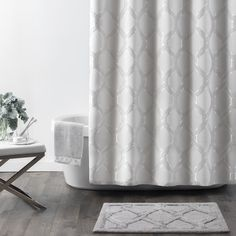The Gwynn Shower Curtain provides a subtle nod to the lap of luxury with its intricate marbleized latticework damask pattern on a woven jacquard fabric. Warm softness in multi-tonal shades of gray contrast with crisp touches of cool silver that add an elegant edge. Give your bathroom space all the character it deserves with this elevated shower essential.