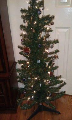 redneck Christmas tree!  Copenhagen lids, beer caps, and bullets!