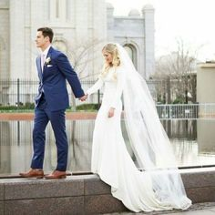 sleek modest wedding dress with long sleeves . .  photo by amber shaw