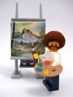 Bob Ross Lego Man :D ; Bob Ross reminds me of Beth and her grandma. They loved his work and painted. Now Beth, Grandma and Bob Ross reside in heaven Legos, Lego Cake Pops, Casa Lego, Figurine Lego, Mike Mitchell, Happy Little Trees, Lego Man, Lego Creationary, Cultura Pop