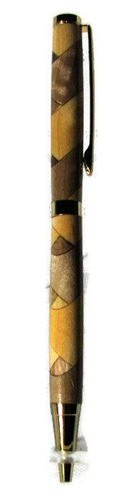 This is a hand turned pen made from a Texas Black Walnut Log and a piece of Willow. As you can tell, the Willow and the Texas Black Walnut is placed at a diagonal with half moons and eyes of the 2 woods peaking out from behind them. The pen finish is high gloss durable acrylic and the mechanism is 24 caret gold plated. This pen take a regular Cross refill.              Member - International Association of Penturners | Shop this product here: http://spreesy.com/MappDesignCo/5 | Shop all of…