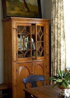 Beautiful antique pine cabinet in kitchen of Charleston designer Kimberly Williams