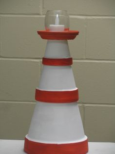 Clay pot lighthouse, table centerpiece size.  These were painted by some of our teens at a craft session at summer camp.
