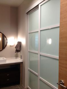 Want a sliding door for your bathroom, but need to save space? Some of our glass wall slides can be top hung with no bottom track, but both our tracked and top hung systems hug the wall and allow you to maximize floor space. Interior Sliding Glass Doors, Sliding Closet Doors, Bathroom Closet, Master Bathroom, Sliding Door Company, Door Dividers, House Styles, Modern, Chicago Style