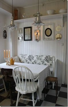 Beautiful, elegant, table with quite an assortment of seating.
