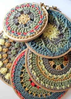 Mandalas crocheted and put on embroidery hoop.