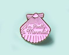 Super cute, magical, pastel pink pin made from gold enamel. This gorgeous pin is engraved with the super cute words Im Really a Mermaid in the centre