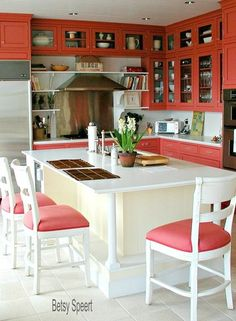 Betsy Speert's Blog:  bold coral cabinets in a crisp cottagey kitchen