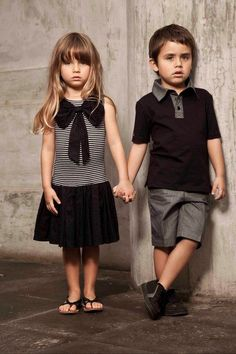 a photo of a boy and a girl vintage matching out style . Represent Liam and I agreeing to join work force, for our family