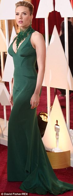 Curves ahead: Scarlett Johansson flashed some cleavage in a forest green number which hugg...