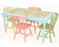 World Mapped Dining Table with Four Multi-Color Chairs.