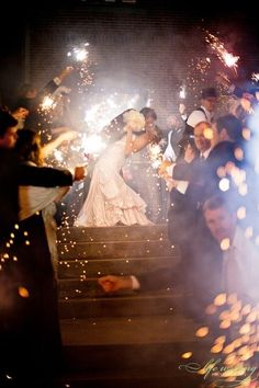 I love this picture - sparklers and a dipped kiss :)