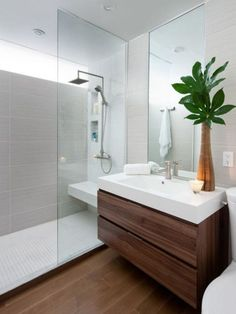 Cool Contemporary White Bathroom That Added the Palm Tree for Decor Accessories Beside the Mirror at the White Sink and Faucet for the Natural Design Ideas That Use the Wooden Floor Tile