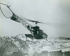 """NH 97103. Bell HTL-4 Helicopter (Bureau # 128623), of Marine aircraft squadron VMO-6. """"Operation 'EVAC' - Amidst a Korean snowstorm, a helicopter of VMO-6 prepares to land with its precious human cargo at 'Easy Med' - hospital site of the First Marine Medical Battalion."""" Photograph and caption released by Commander Naval Forces, Far East, under date of 24 February 1952. Official U.S. Navy Photograph, from the """"All Hands"""" collection at the Naval History and Heritage Command."""