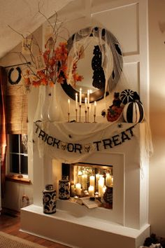 Sweet Something Designs: Halloween Mantle 2011 and LOVE the way she hot glued mirrored tiles on back of fireplace to reflect the light