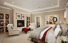 Fabric in red set against white goes along with the charming fireplace!