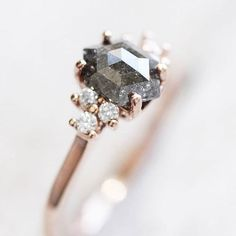 We're having a thing with black diamonds lately aren't they sexy? We are sharing our top 20 picks of black  salt and pepper diamond rings on #ruffledblog! ring @midwinterco
