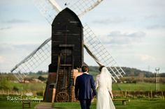 Rustic May Wedding. The Bride and Groom enjoying the views over the Worcestershire countryside by the Windmill at Avoncroft Museum of Historic Buildings (avoncroft.org.uk). Rob & Sarah Gillespie Photographers.