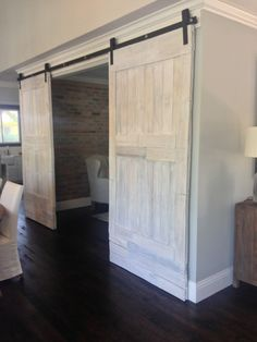 whitewashed barn door could lighten things up a bit