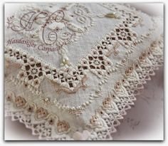 Hardanger Bridal Pillow with lacy edging ~ by El goce de la aguja y el pincel   What a beautiful example of stitched art!  The textures are incredible.