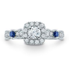 The ring's diamond-lined shank features two round blue sapphires that add color and sparkle.