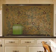 Mosaic tiles on a backsplash don't have to be aligned in straight rows and columns. This free-form floral version reflects the fun spirit of the young family that uses the kitchen./