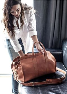 I Love Everything about this.From the weekender bag to the crisp white shirt with the Denim.