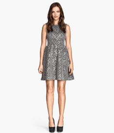 H&M Glittery sleeveless dress in jacquard-patterned jersey. Seam at waist, cut-out sections at back, and gently flared skirt. Jersey lining.