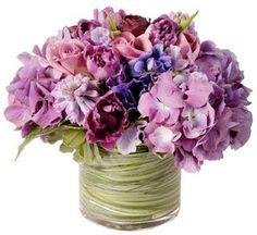 Beautiful, rustic, purple wedding reception flowers