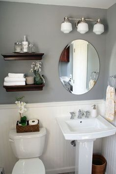 Simple Powder Room or small bathroom with gray walls and beadboard / wainscoting. I don't usually like pedestal sinks, but it all looks good in here. #PowderRoom #SmallBathroom