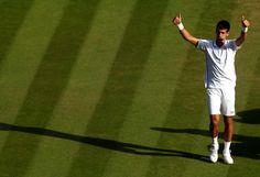 Novak Djokovic of Serbia celebrates winning the Gentlemen's Singles Final match against Roger Federer of Switzerland on day thirteen of the Wimbledon Lawn Tennis Championships at the All England Lawn Tennis and Croquet Club on July 6, 2014 in London, England.