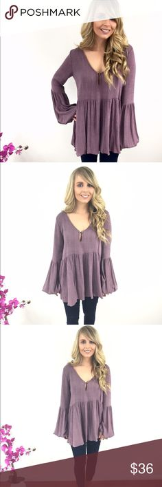 Purple top with button keyhole This top features a keyhole button neckline, long sleeves and a flowy bottom. This is the perfect top for a date night.  -62% Polyester   -32% Rayon  -Spandex  -Wearing size small Tops Blouses