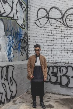 Suede bomber jacket paired with color block sweater and long cardigan | #menswear #streetstyle