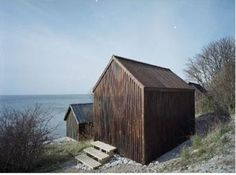 """beach cabins in Gotland by Sandell Sandberg """"The pine facade panels were treated with a tar and linseed oil varnish, a traditional Swedish treatment for houses built near the sea."""""""