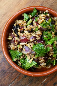 Farro salad with toasted pine nuts, currants, and mustard greens #food #recipe