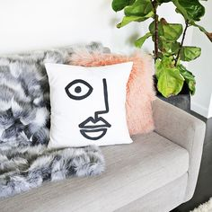 This DIY abstract art pillow might just be the thing your living room is missing.